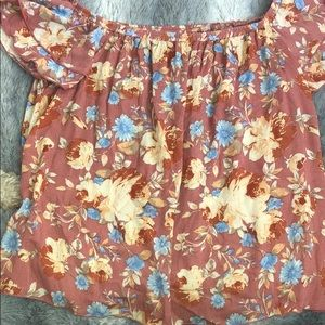 A flower blouse off the shoulders